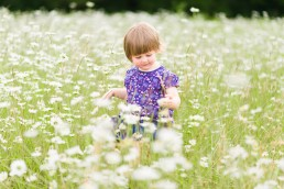 photo of a small child in the daisies