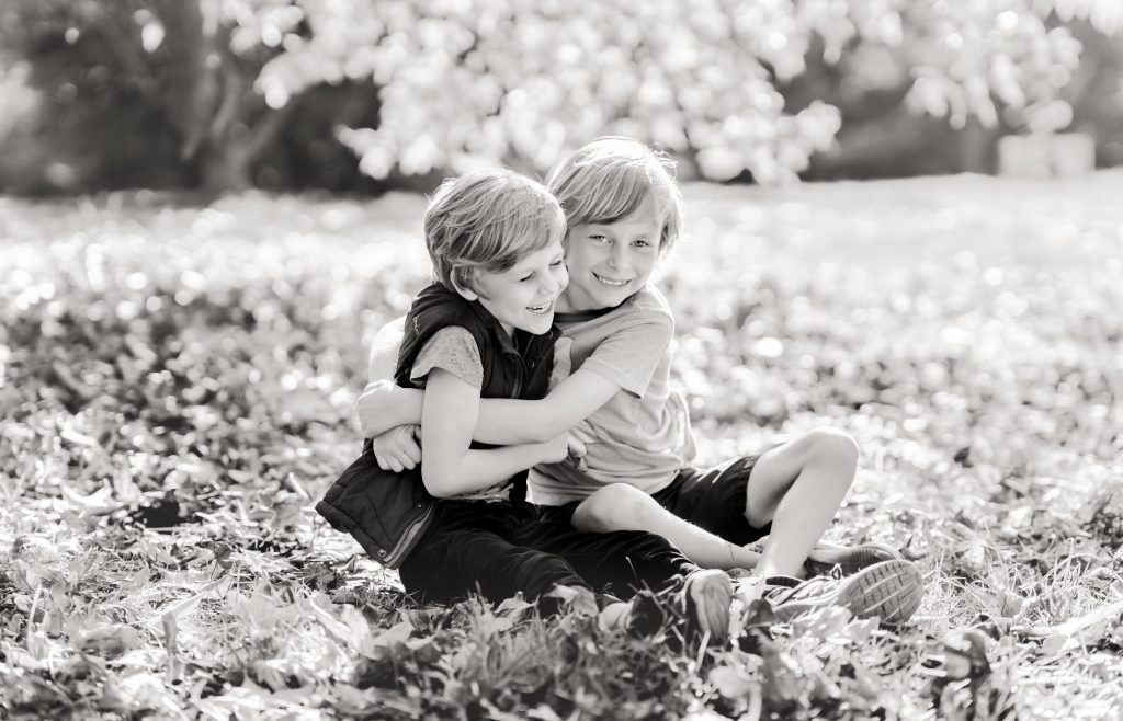 Black and white outdoor family photograph by Belinda Grant Photography